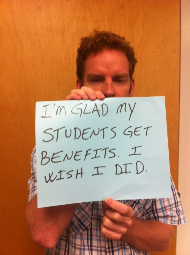 "Contract faculty member holding a sign saying, ""I'm glad my students get benefits. I wish I did."""