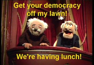 "Statler and Waldorf from the Muppets saying ""Get your democracy off my lawn! We're having lunch!"""