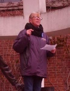 Photograph of Michele Kramer, president of WLUFA, making a speech.